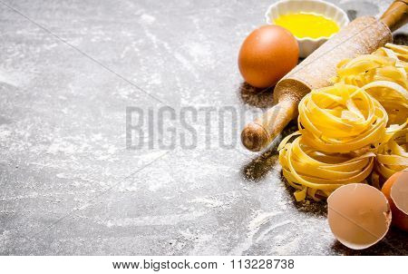 Preparated Dry Pasta With A Rolling Pin And Eggs.