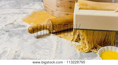Cooking Noodles. The Pasta Maker With A Rolling Pin And Egg.