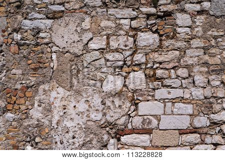 Old Abstract Texture Of A Destroyed Stone Wall