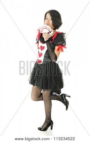 A beautiful young teen proudly displaying all the heart cards in a deck, with a new Queen of Hearts (herself) in front.  On a white background.