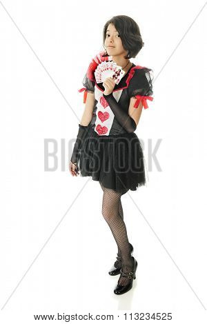 Full length image of a beautiful young teen in a pretty valentine outfit displaying a handful of heart cards, with herself as the queen on top.  On a white background.
