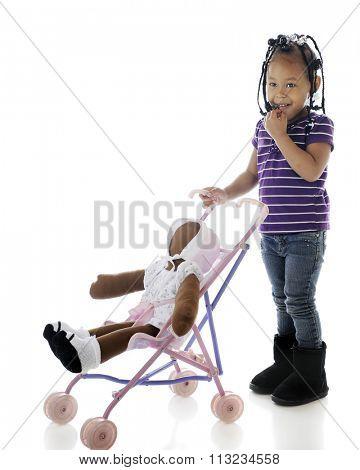 A shy preschooler pushing her