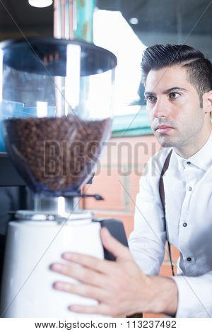 Close-up Of Bartender Grinding Coffee Beans