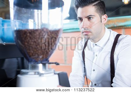Close-up Of Bartender Grinds Coffee Beans
