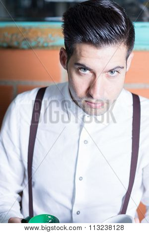 Portrait Of Handsome Barista Looking At Camera
