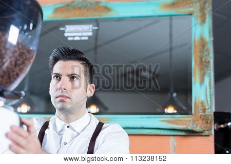 Portrait Of Serious Bartender Working