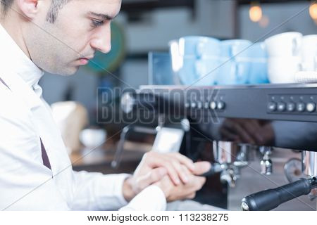 Side View Of Male Bartender Making Coffee