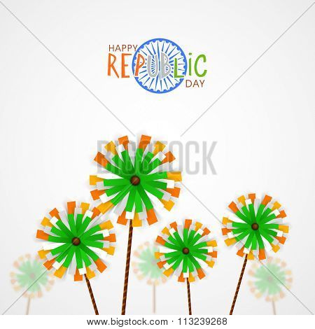 Creative pinwheels on grey background for Happy Indian Republic Day celebration.