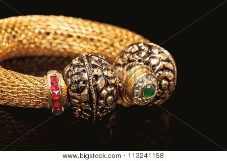 Close up of golden bangle.