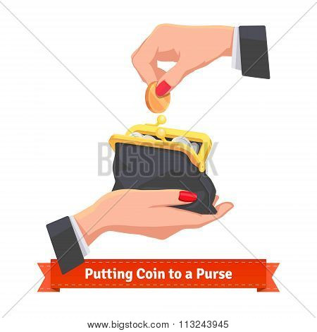 Woman hands putting coin to a black purse