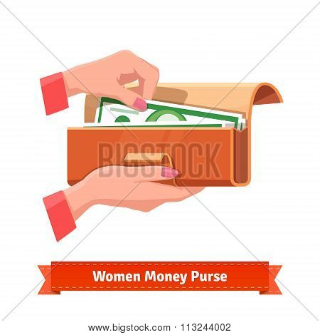 Woman hands taking out banknote from a purse