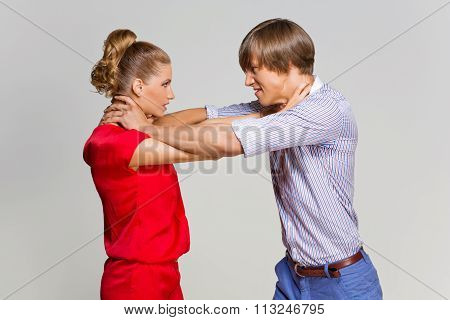 Couple strangling each other