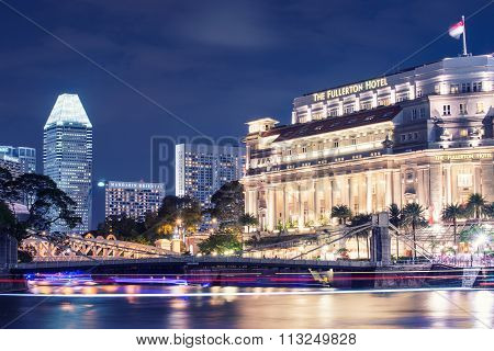 SINGAPORE - May 13 : The Fullerton Hotel Singapore at light on May 13, 2014 in Singapore. It is is