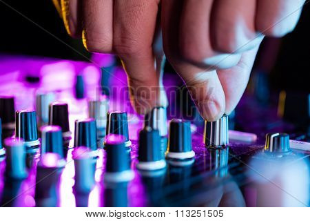 DJ turntable console mixer controlling with two hands