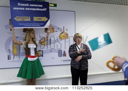 ST. PETERSBURG, RUSSIA - OCTOBER 24, 2015: Quest for visitors of the Baltika - St Petersburg brewery during the October Beer Festival. The brewery provides guided tours to the plant regularly