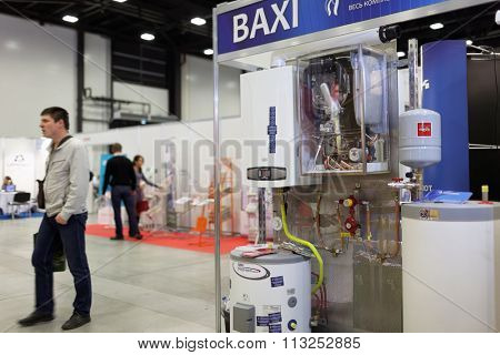 ST. PETERSBURG, RUSSIA - OCTOBER 31, 2015: Visitors and the exhibition of heating equipment of BAXI company during the Real Estate Fair. It is the largest real estate exhibition in Russia