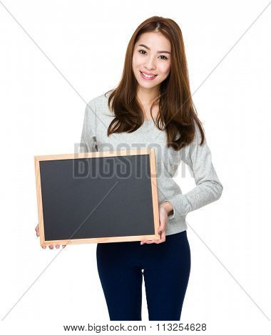 Woman showing with chalkboard