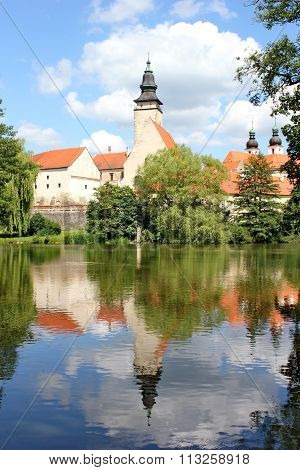 fairy tale castle and its mirror image on the surface of the pond, Telc, Moravia, Czech republic