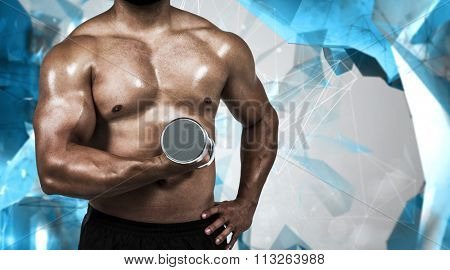 Muscular man lifting heavy dumbbell against angular design