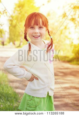 Cute redhead little girl.