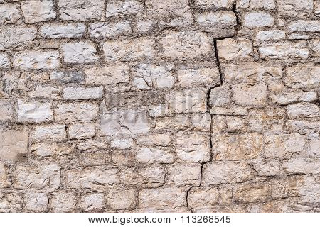 Old Abstract Texture With Crack Of A Stone Wall