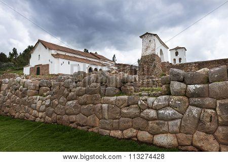 Inca ruins and church in the village of Chinchero, in Peru