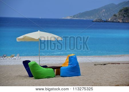 Multicolored Arm-chair On The Beach