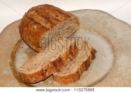 Loaf and slices of wholegrain bread