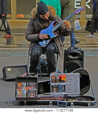 street musician is playing guitar in outdoor, Milan