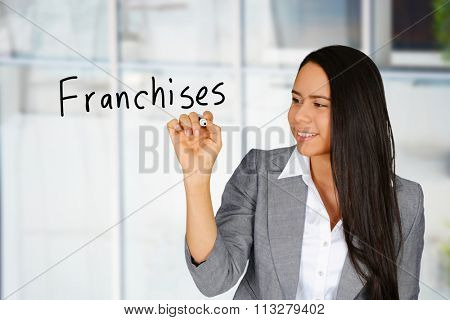 Confident businesswoman who is selling business franchises