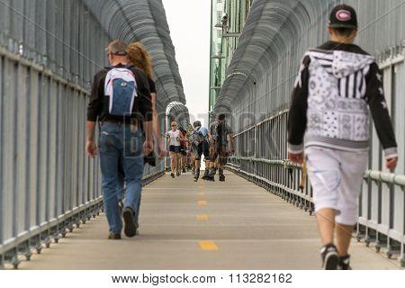 Montreal, Canada - June 07, 2015:people Walking At Bicycle Road On Jack Cartier Bridge Over Saint La