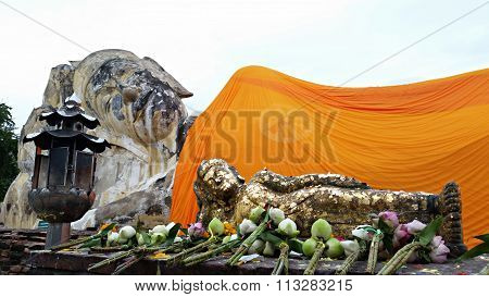 Giant Laying Buddha And Small Model And Buddhism Faith