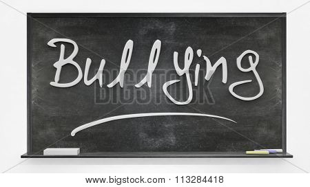 Bullying written on blackboard