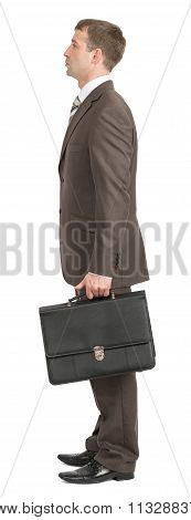 Businessman standing with suitcase