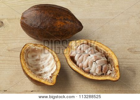 Whole and half fresh ripe cacao fruit and seeds