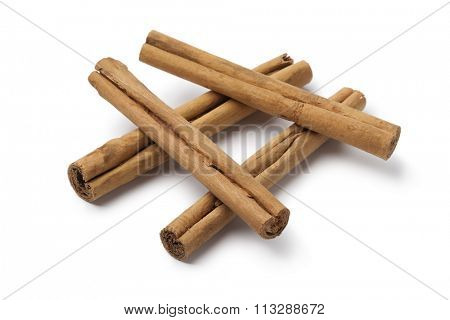 True cinnamon sticks close up on white background