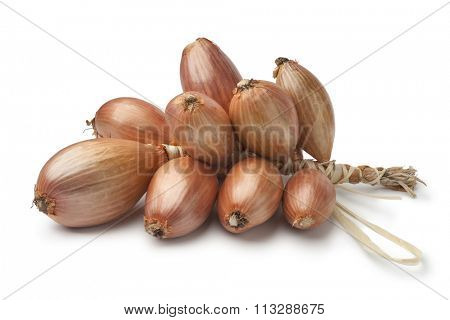 Bunch of fresh brown french shallots on white background