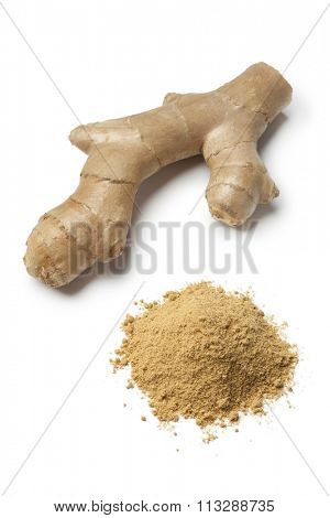 Fresh ginger rhizome and a heap of ground ginger on white background