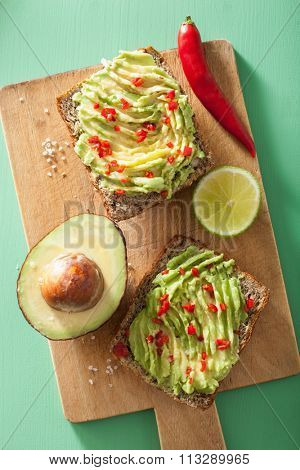healthy wholegrain toast with avocado lime chili