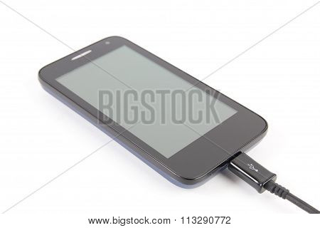 Close up black smartphone and USB cable isolated on white background