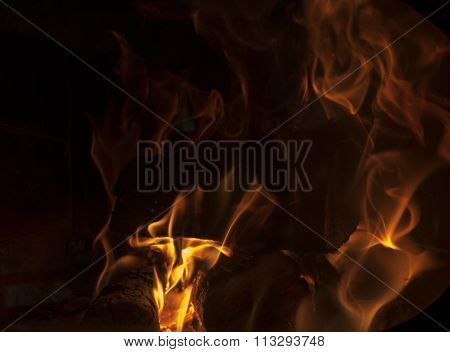 Burning Wood In The Fireplace On A Black Background