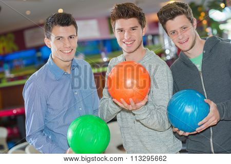 three men with bowling balls