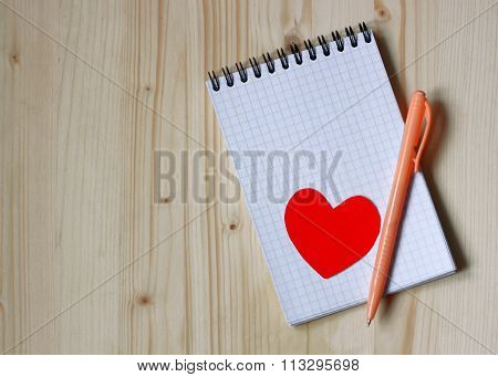 Heart, A Notebook And Pen.
