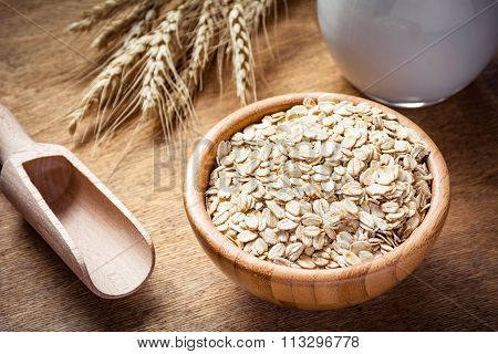 Oatmeal (rolled oats, oat flakes) in wooden bowl