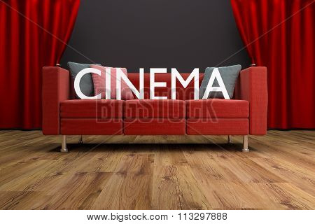 Red Couch In Front Of Large Cinema Curtain