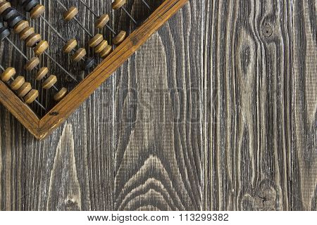 Abacus  Lying On A Wooden Table. Background Top View