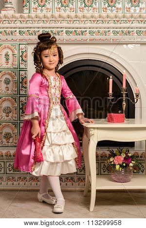 Girl in an ancient dress fireplace