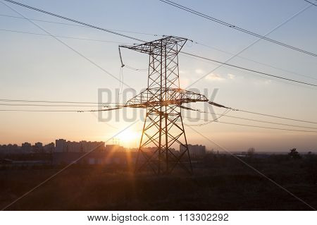 Electricity Pylon Against The Sunset