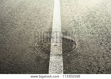 Manhole Cover On The Road