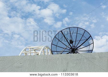 Satellite Dish Transmission Data On Blue Sky Background.